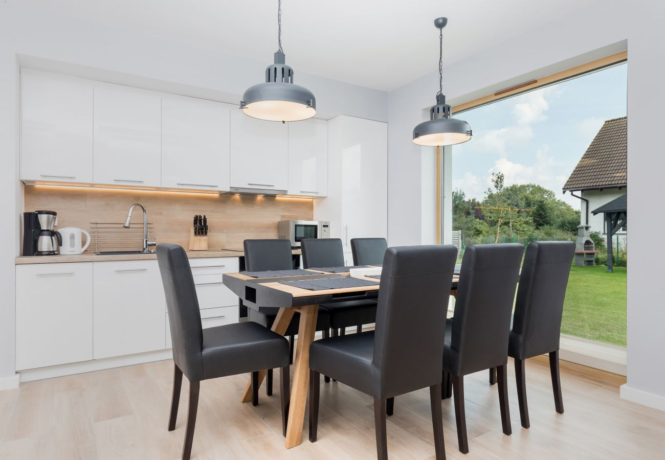 dining area, dining table, chairs, kitchenette, coffee machine, kettle, sink, knives, refrigerator, rent