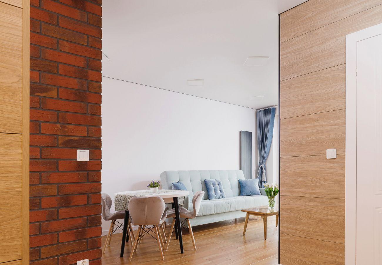 salon, sofa, stolik kawowy, jadalnia, stół, krzesła, telewizor, mieszkanie, wnętrze, wynajem